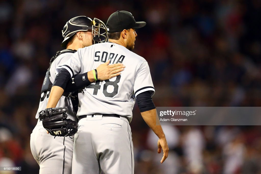 Kevan Smith #36 embraces Joakim Soria #48 of the Chicago White Sox after a victory over the Boston Red Sox at Fenway Park on June 08, 2018 in Boston, Massachusetts.