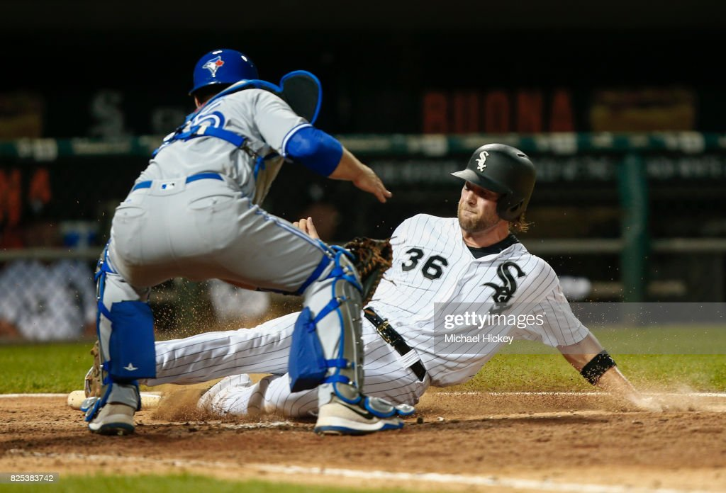 Kevan Smith #36 of the Chicago White Sox is tagged out at home by Russell Martin #55 of the Toronto Blue Jays in the eighth inning at Guaranteed Rate Field on August 1, 2017 in Chicago, Illinois.