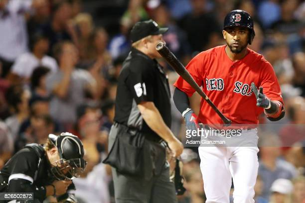 Kevan Smith of the chicago White Sox looks on as Eduardo Nunez of the Boston Red Sox tosses his bat after hitting a solo home run in the sixth inning...