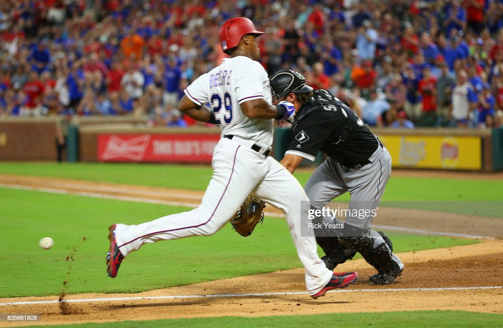 Kevan Smith #36 of the Chicago White Sox misses the tag on Adrian Beltre #29 of the Texas Rangers in the third inning at Globe Life Park in Arlington on August 19, 2017 in Arlington, Texas.