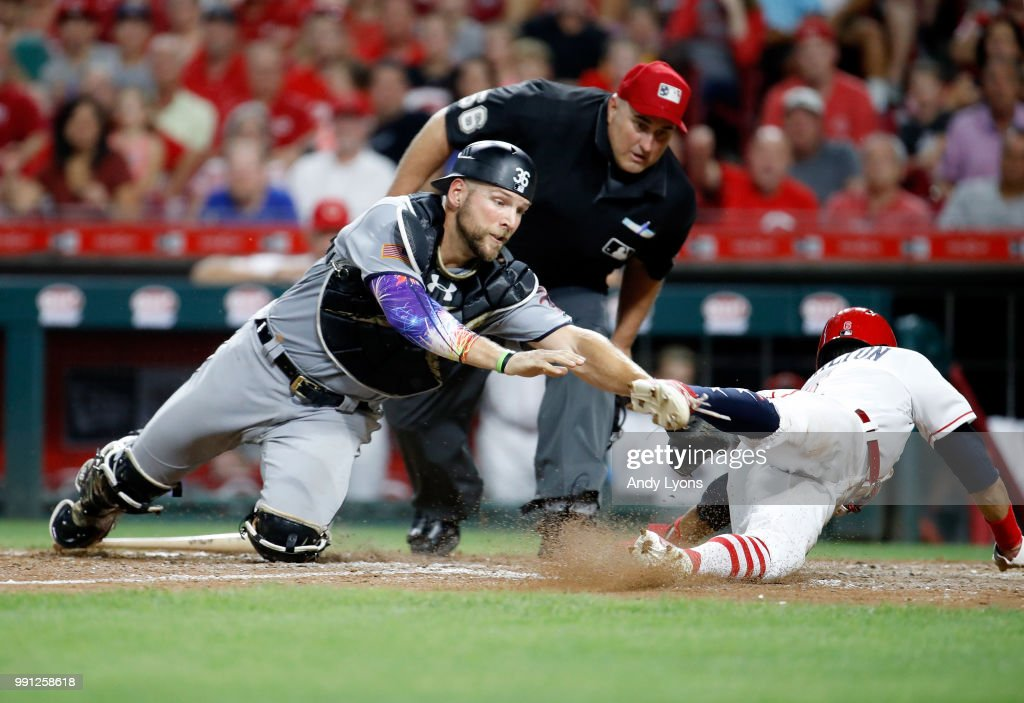 Kevan Smith #36 of the Chicago White Sox reaches out to tag Billy Hamilton #6 of the Cincinnati Reds in the 8th innings at Great American Ball Park on July 3, 2018 in Cincinnati, Ohio. Hamilton was ruled safe on the play but the Reds lost 12-8 in 12 innings.
