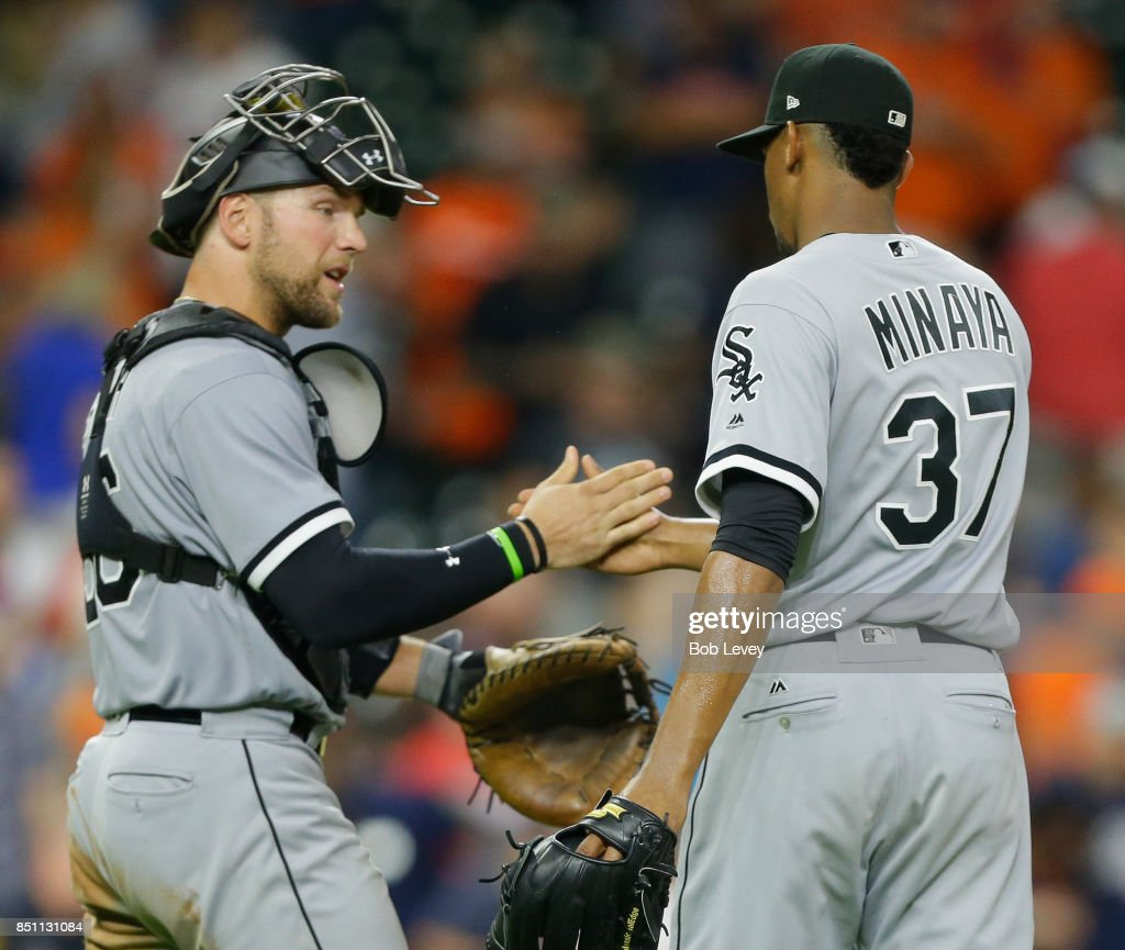 Kevan Smith #36 of the Chicago White Sox shakes hands with Juan Minaya #37 after the final out against the Houston Astros at Minute Maid Park on September 21, 2017 in Houston, Texas.