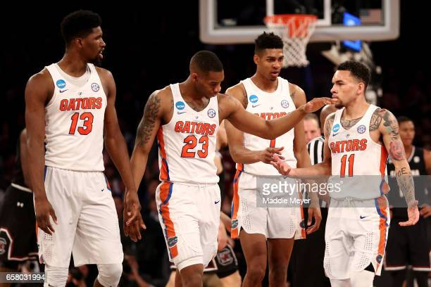Kevarrius Hayes Justin Leon Devin Robinson and Chris Chiozza of the Florida Gators react in the first half against the South Carolina Gamecocks...