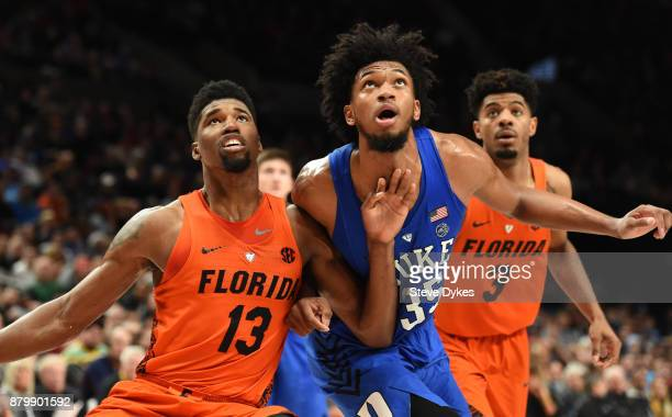 Kevarrius Hayes of the Florida Gators Marvin Bagley III of the Duke Blue Devils and Jalen Hudson of the Florida Gators battle for position under the...