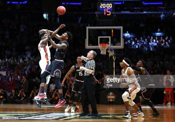 Kevarrius Hayes of the Florida Gators tips the ball off against Chris Silva of the South Carolina Gamecocks in the first half during the 2017 NCAA...