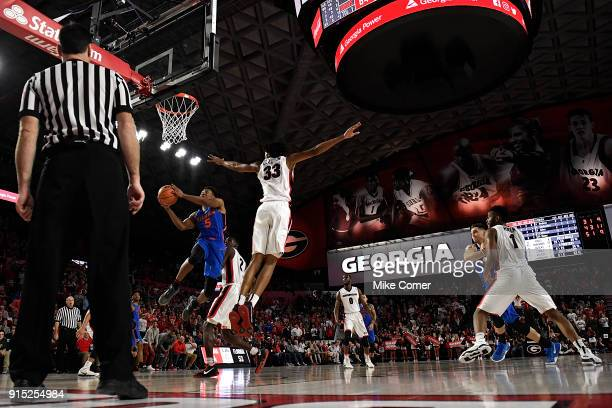 KeVaughn Allen of the Florida Gators drives past Nicolas Claxton of the Georgia Bulldogs late in the second half of the basketball game at Stegeman...