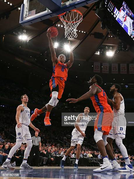 KeVaughn Allen of the Florida Gators puts up a layup against the Duke Blue Devils in the first half during the Jimmy V Classic at Madison Square...