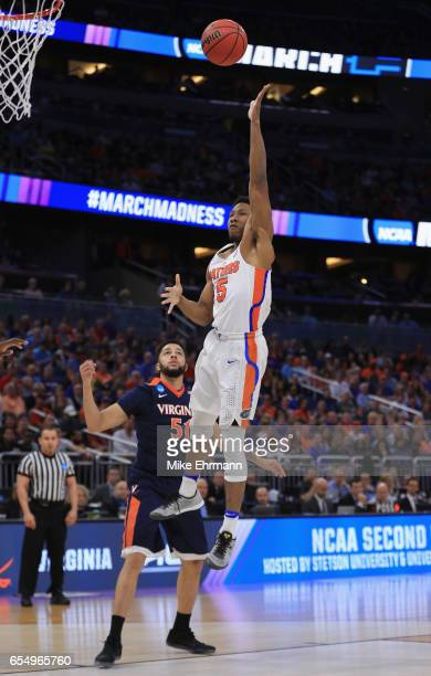 KeVaughn Allen of the Florida Gators shoots against Darius Thompson of the Virginia Cavaliers in the first half during the second round of the 2017...