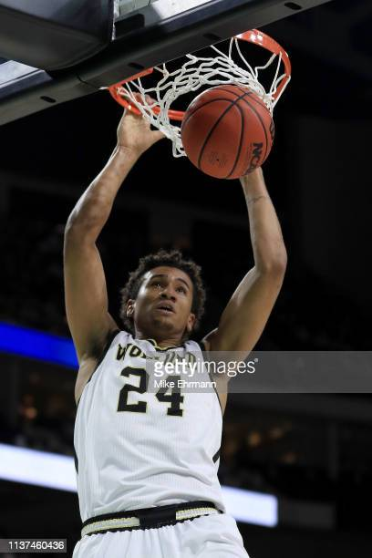 Keve Aluma of the Wofford Terriers dunks the ball in the first half against the Seton Hall Pirates during the first round of the 2019 NCAA Men's...
