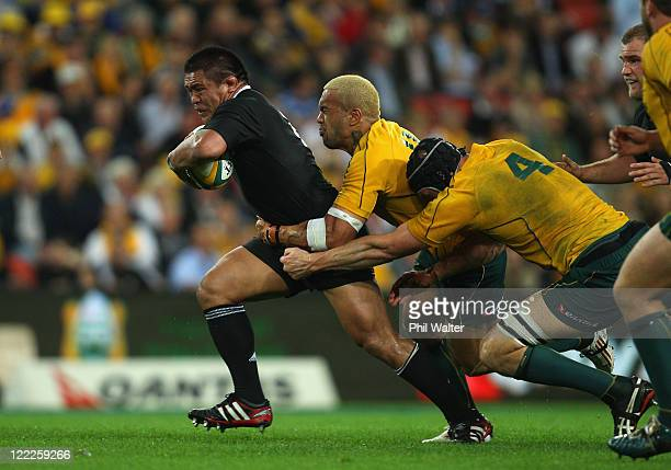 Keven Mealamu of the All Blacks is tackled by Digby Ioane and Dan Vickerman of the Wallabues during the TriNations Bledisloe Cup match between the...