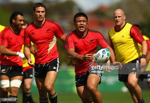 Keven Mealamu of the All Blacks passes during a New Zealand All Blacks IRB Rugby World Cup 2011 training session at Trusts Stadium on October 14 2011...