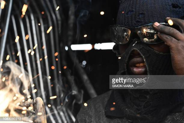 Kevin a Jua kali artisan works making house hold items in Gikomba Market in Nairobi Kenya January 15 2019 An estimated 831 per cent of the country's...