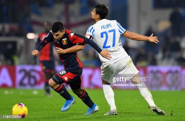 Kevin Agudelo of Genoa CFC competes for the ball with Simone Missiroli of SPAL during the Serie A match between SPAL and Genoa CFC at Stadio Paolo...