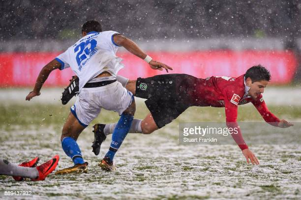 Kevin Akpoguma of 1899 Hoffenheim and Pirmin Schwegler of Hannover 96 battle for the ball during the Bundesliga match between Hannover 96 and TSG...