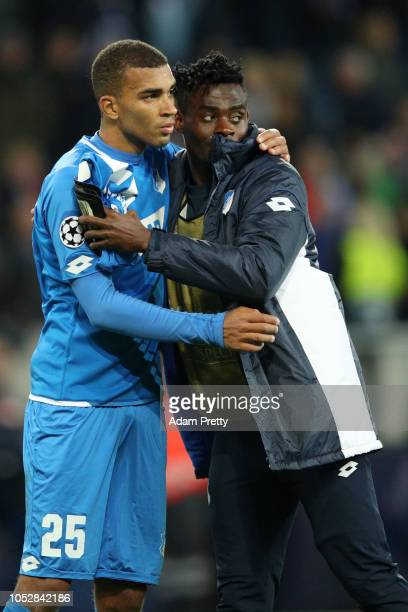 Kevin Akpoguma of 1899 Hoffenheim speaks with Kasim Adams of 1899 Hoffenheim after the Group F match of the UEFA Champions League between TSG 1899...
