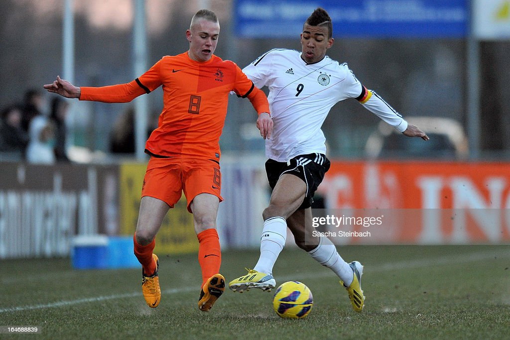 Kevin Akpoguma of Germany (R) and Rick Karsdorp of The Netherlands (L) battle for the ball during the U18 International Friendly match between The Netherlands and Germany on March 26, 2013 in Vriezenveen, Netherlands.