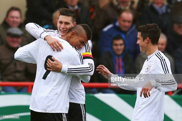 Kevin Akpoguma of Germany celebrates his team's second goal with team mates Niklas Suele and Marc Oliver Kempf during the U18 international friendly...