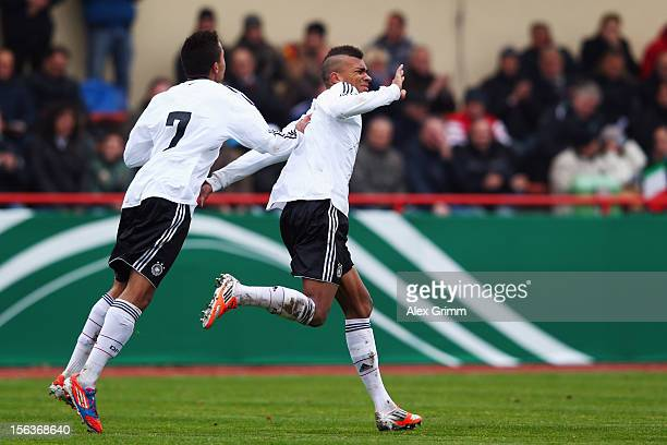 Kevin Akpoguma of Germany celebrates his team's second goal with team mate Jan Gyamerah during the U18 international friendly match between Germany...