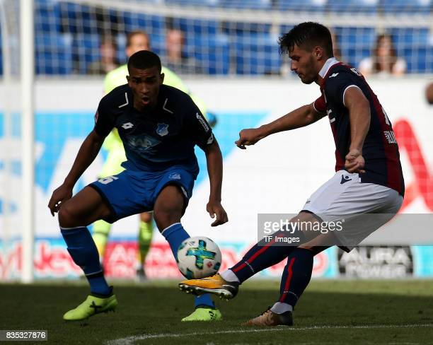 Kevin Akpoguma of Hoffenheim and Bruno Petkovic of Bologna battle for the ball during the preseason friendly match between TSG 1899 Hoffenheim and FC...