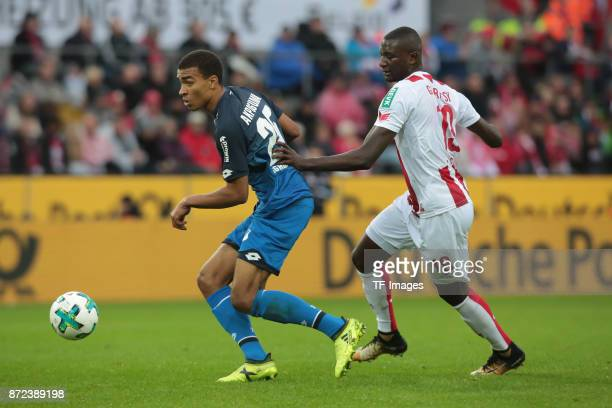 Kevin Akpoguma of Hoffenheim and Sehrou Guirassy of FC Koeln battle for the ball during the Bundesliga match between 1 FC Koeln und TSG 1899...