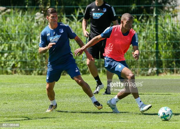 Kevin Akpoguma of Hoffenheim and Steven Zuber of Hoffenheim battle for the ball during the Training Camp of TSG 1899 Hoffenheim on July 16 2017 in...