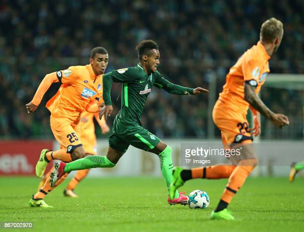 Kevin Akpoguma of Hoffenheim and Theodor Gebre Selassie of Bremen Kevin Vogt of Hoffenheim battle for the ball during the DFB Cup match between...