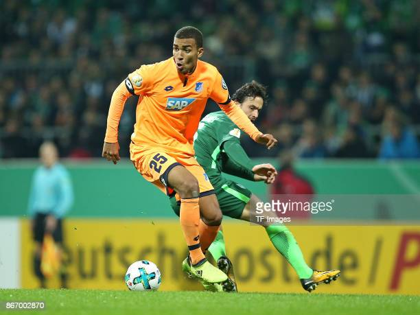 Kevin Akpoguma of Hoffenheim and Thomas Delaney of Bremen battle for the ball during the DFB Cup match between Werder Bremen and 1899 Hoffenheim at...