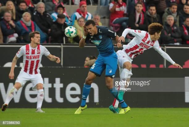 Kevin Akpoguma of Hoffenheim and Yuya Osako of FC Koeln battle for the ball during the Bundesliga match between 1 FC Koeln und TSG 1899 Hoffenheim at...