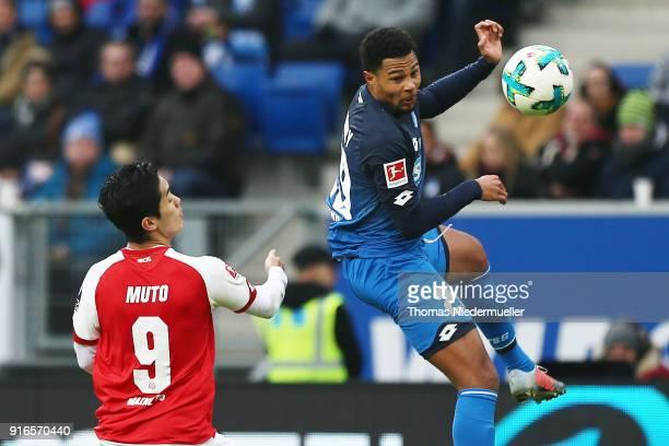 Kevin Akpoguma of Hoffenheim fights for the ball with Yoshinori Muto of Mainz during the Bundesliga match between TSG 1899 Hoffenheim and 1 FSV Mainz...