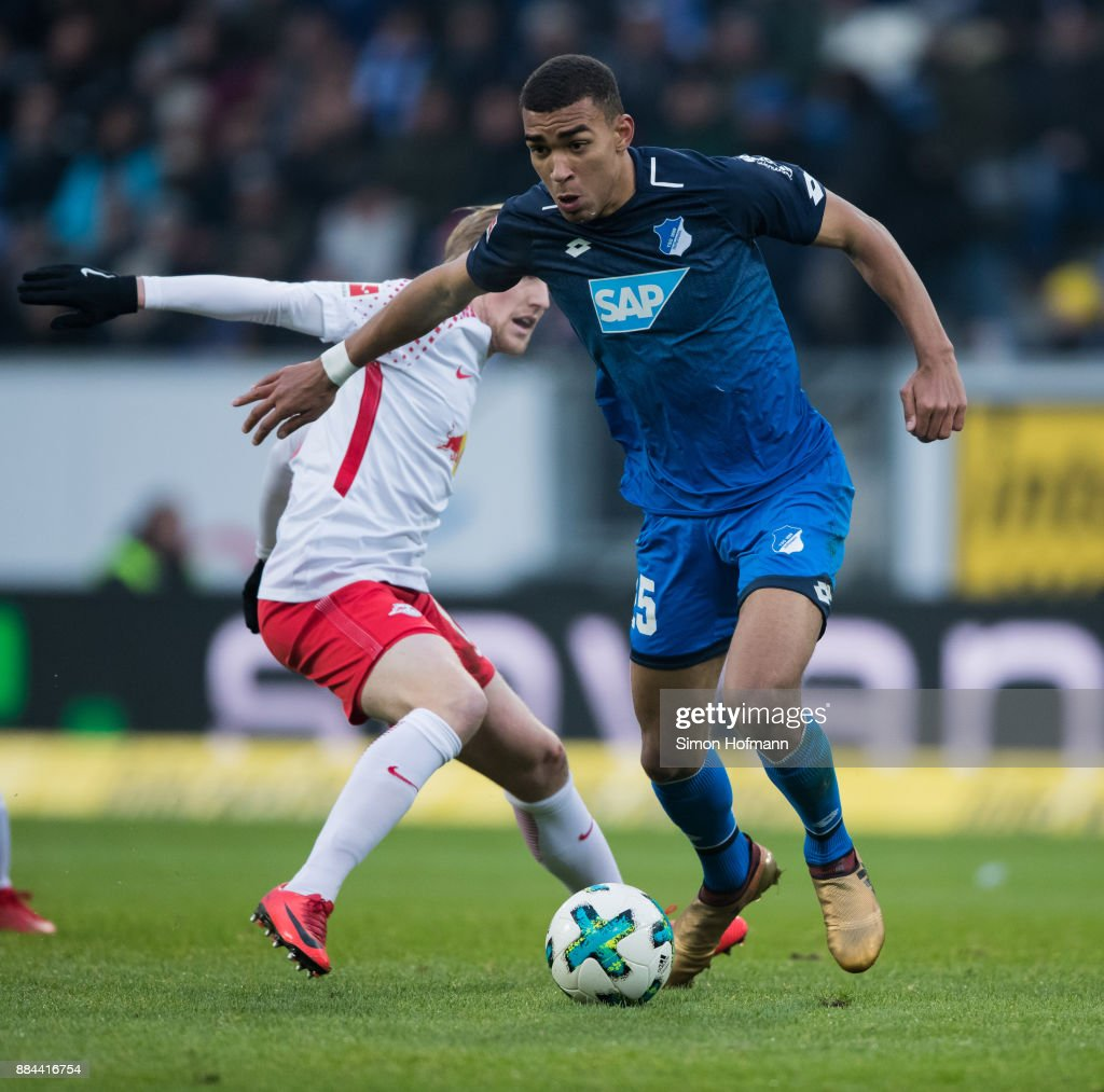 Kevin Akpoguma of Hoffenheim is challenged by Emil Forsberg of Leipzig during the Bundesliga match between TSG 1899 Hoffenheim and RB Leipzig at Wirsol Rhein-Neckar-Arena on December 2, 2017 in Sinsheim, Germany.