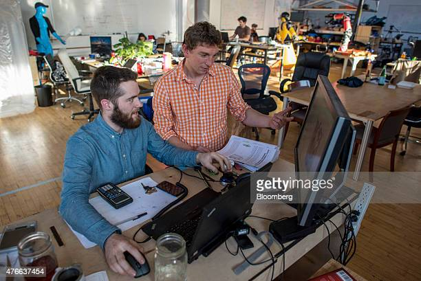 Kevin Albert cofounder and chief executive officer at Pneubotics a division of Otherlab right talks with an employee at the company's office in San...