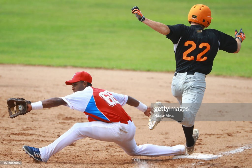 Kevin Alcolea #66 of Cuba tagged out Darnel Collins #22 of Netherlands during the WBSC U-15 World Cup Group B match between Netherlands and Cuba at Estadio Rico Cedeno on August 10, 2018 in Chitre, Panama.