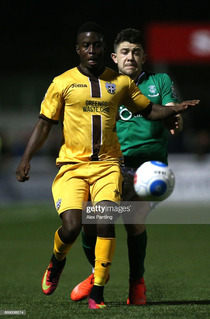 Kevin Amankwaah of Sutton United and Sam Habergan of Lincoln City in action during the Vanarama National League match between Sutton United and Lincoln City at Gander Green Lane on March 28, 2017 in Sutton, Greater London.