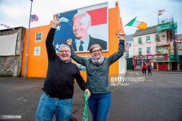Kevin and Elizabeth Nestor, who have just moved back home to Ballina, north west Ireland, from Pennsylvania, celebrate the election win of US...