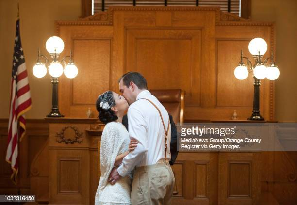 Kevin and Jen Long, of Laguna Niguel, kiss after being married by Orange County Clerk-Recorder Hugh Nguyen at the Old County Courthouse in Santa Ana...