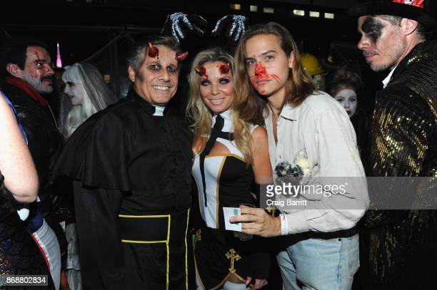Kevin and Jenn Mazur and actor Dylan Sprouse at Heidi Klum's 18th Annual Halloween Party sponsored by Party City and SVEDKA Vodka at Magic Hour at...