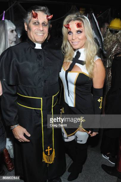 Kevin and Jenn Mazur attend Heidi Klum's 18th Annual Halloween Party sponsored by Party City and SVEDKA Vodka at Magic Hour at Moxy Times Square on...