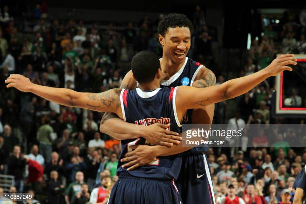 Kevin Anderson and Justin Harper of the Richmond Spiders celebrate after defeating the Vanderbilt Commodores during the second round of the 2011 NCAA...