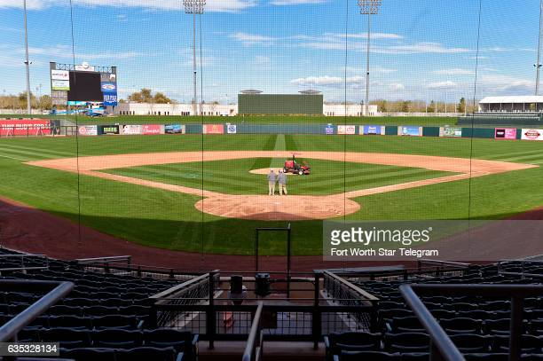 Kevin Anderson and Tony Frontzak work on mowing the grass at Surprise Stadium in preparation for the opening of the Texas Rangers spring training in...