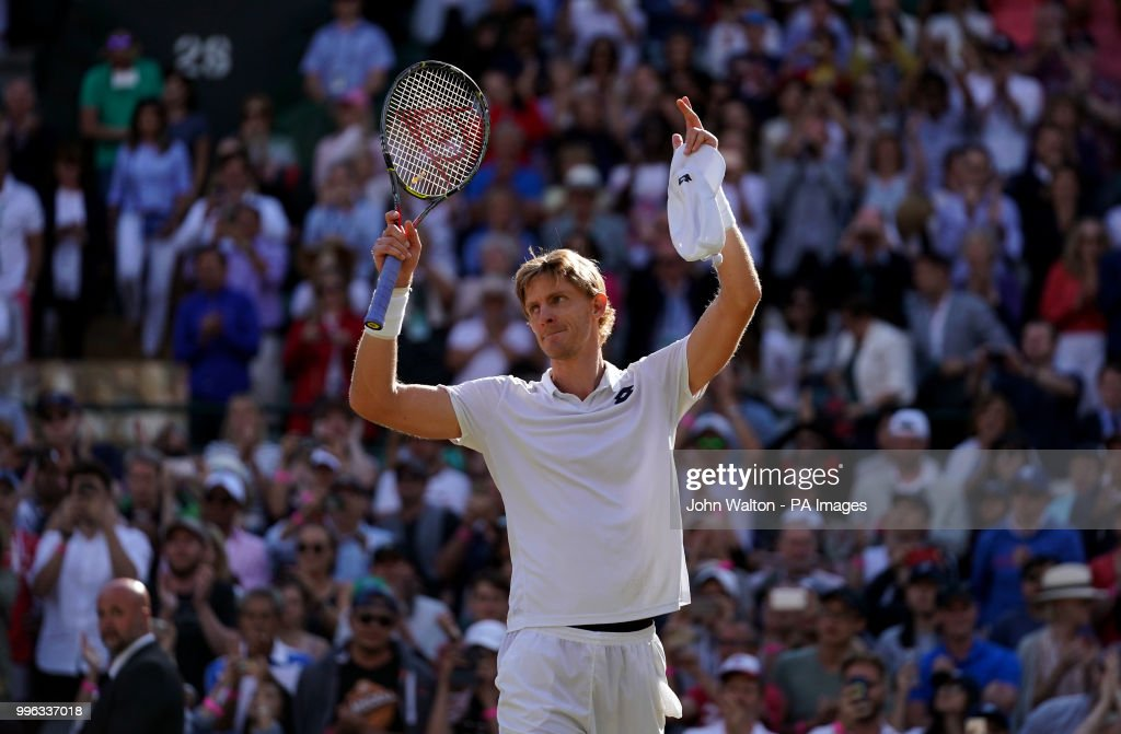 Kevin Anderson celebrates his win against Roger Federer on day nine of the Wimbledon Championships at the All England Lawn Tennis and Croquet Club, Wimbledon.