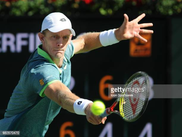 Kevin Anderson hits a backhand shot during the third set of a quarterfinals match played during the BNP Paribas Open on March 15 2018 at the Indian...