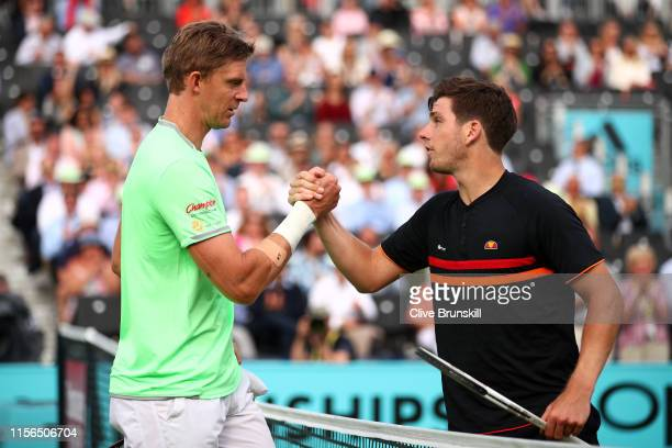 Kevin Anderson of South Africa and Cameron Norrie of Great Britain shake hands at the net following their First Round Singles Match during Day One of...
