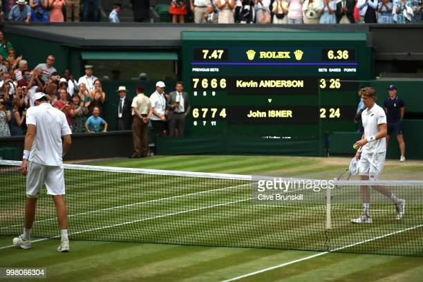 Kevin Anderson of South Africa and John Isner of The United States react to match point at the end of their Men's Singles semifinal match on day...