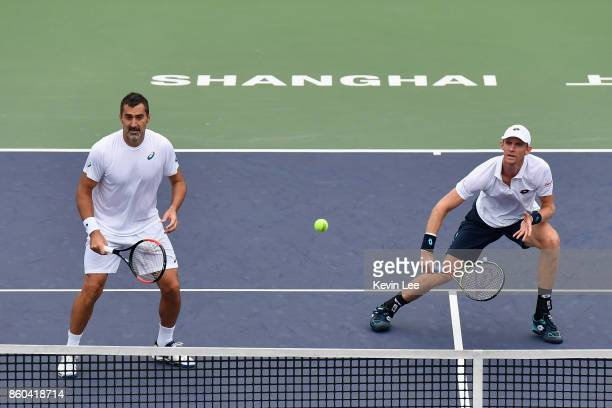Kevin Anderson of South Africa and Nenad Zimonjic of Serbia in action against Jamie Murray of Great Britain and Bruno Soares of Brazil in their Men's...