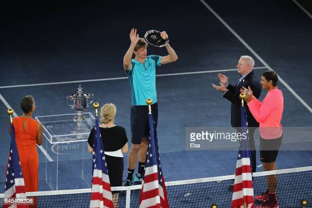 Kevin Anderson of South Africa and Rafael Nadal of Spain pose during the trophy ceremony after their Men's Singles Finals match on Day Fourteen of...