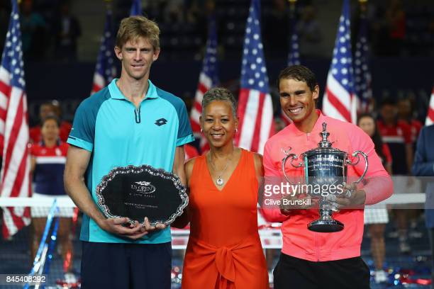 Kevin Anderson of South Africa and Rafael Nadal of Spain pose with USTA President Katrina Adams during the trophy ceremony after their Men's Singles...