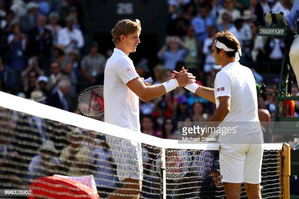 Kevin Anderson of South Africa and Roger Federer of Switzerland embrace at the net following their Men's Singles QuarterFinals match on day nine of...