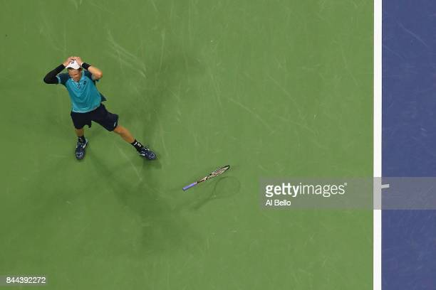 Kevin Anderson of South Africa celebrates after defeating Pablo Carreno Busta of Spain in their Men's Singles Semifinal match on Day Twelve of the...