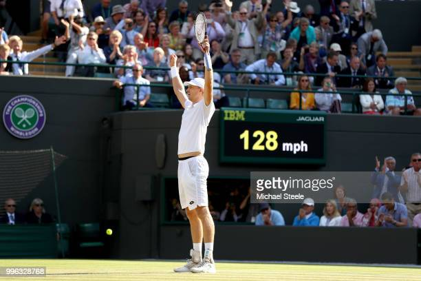 Kevin Anderson of South Africa celebrates winning match point against Roger Federer of Switzerland during their Men's Singles QuarterFinals match on...
