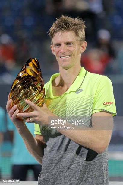 Kevin Anderson of South Africa celebrates with the trophy after his final match against Roberto Bautista Agut of Spain on day three of the Mubadala...